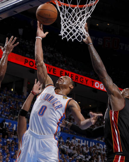 Oklahoma City's Russell Westbrook (0) goes for the ball beside Miami's LeBron James, at right, during Game 2 of the NBA Finals between the Oklahoma City Thunder and the Miami Heat at Chesapeake Energy Arena in Oklahoma City, Thursday, June 14, 2012. Photo by Sarah Phipps, The Oklahoman