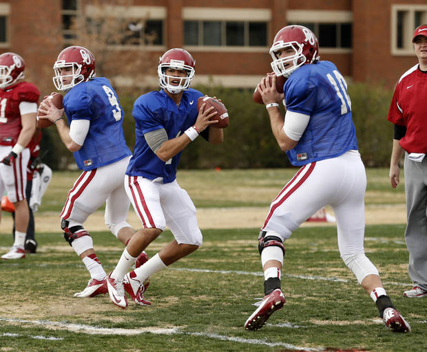 Oklahoma quarterbacks Trevor Knight, Kendal Thompson and Blake Bell, from left, have remained friends throughout an intense position battle. PHOTO BY STEVE SISNEY, THE OKLAHOMAN