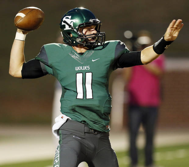 Edmond Santa Fe's Justice Hansen (11) looks to pass during a high school football game between Edmond Santa Fe and Southmoore at Wantland Stadium in Edmond, Okla., Thursday, Sept. 20, 2012. Photo by Nate Billings, The Oklahoman