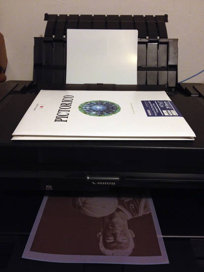 A negative is printed on transparency paper to be used for contact printing.