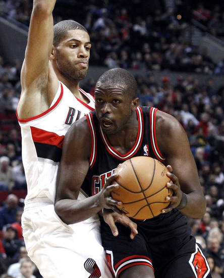 Portland Trail Blazers forward Nicolas Batum, left, from France, plays tight defense on Chicago Bulls forward Luol Deng during the first quarter of their NBA basketball game in Portland, Ore., Sunday, Nov. 18, 2012. (AP Photo/Don Ryan)