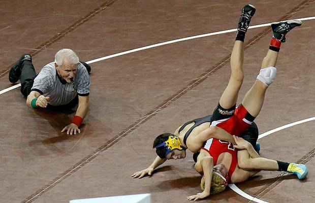 Newkirk's Briar Stopp, center, wrestles Locust Grove's Braden Bennett in the Class 3A 113-pound Championship match during the state wrestling championships at the State Fair Arena in Oklahoma City, Saturday, Feb. 23, 2013. Photo by Bryan Terry, The Oklahoman