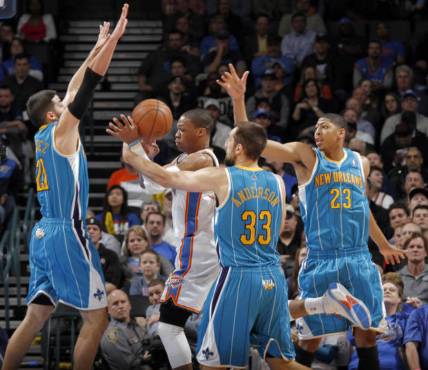 New Orleans Hornets' Greivis Vasquez (21), Ryan Anderson (33) and Anthony Davis (23) defend on Oklahoma City Thunder's Russell Westbrook (0) during the NBA basketball game between the Oklahoma CIty Thunder and the New Orleans Hornets at the Chesapeake Energy Arena on Wednesday, Dec. 12, 2012, in Oklahoma City, Okla.   Photo by Chris Landsberger, The Oklahoman