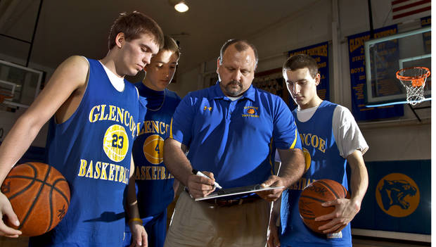 JAKE LAZENBY / TY LAZENBY / JOHN LAZENBY: Glencoe High School basketball coach John Lazenby poses for a photo with his three sons Jake, Ty and John, from left at Glencoe High School on Wednesday, Feb. 29, 2012 in Glencoe, Okla.  Photo by Chris Landsberger, The Oklahoman
