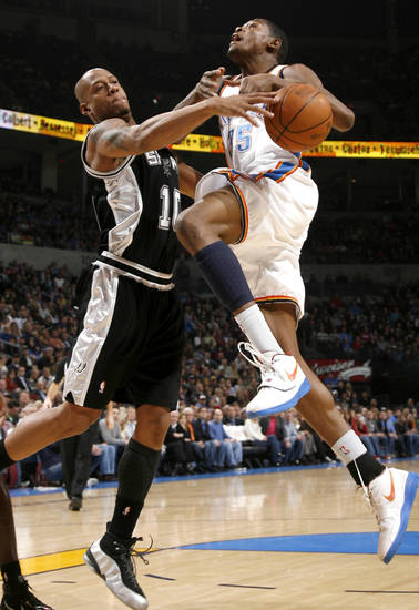 San Anotnio's Keith Bogans blocks the shot of Oklahoma City's Kevin Durant during the NBA basketball game between the Oklahoma City Thunder and the San Antonio Spurs at the Ford Center in Oklahoma City, Wednesday, January 13, 2010. Photo by Bryan Terry, The Oklahoman