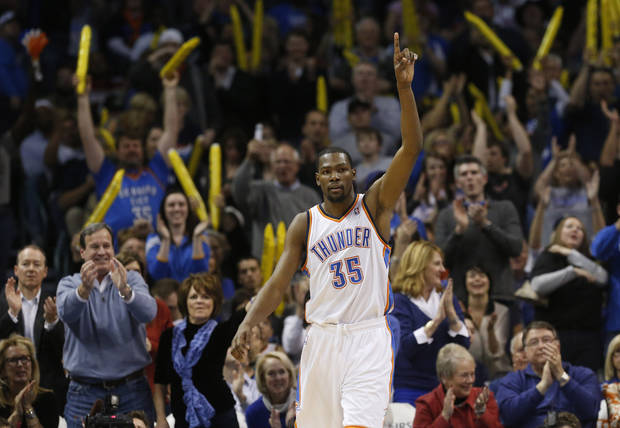Oklahoma City Thunder forward Kevin Durant (35) and the crowd react to a dunk by Durant against the San Antonio Spurs in the fourth quarter of an NBA basketball game in Oklahoma City, Monday, Dec. 17, 2012. Oklahoma City won 107-93. (AP Photo/Sue Ogrocki)
