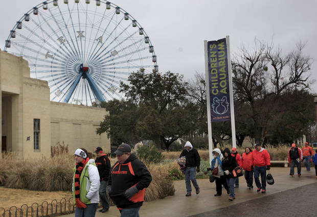 Fans walk to the Cotton Bowl before the Heart of Dallas Bowl football game between the Oklahoma State University (OSU) and Purdue University at the Cotton Bowl in Dallas,  Tuesday, Jan. 1, 2013. Photo by Sarah Phipps, The Oklahoman
