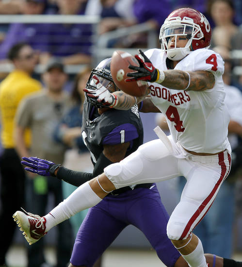 Oklahoma&#039;s Kenny Stills (4) reaches for the ball as TCU&#039;s Chris Hackett (1) is called for pass interference during a college football game between the University of Oklahoma Sooners (OU) and the Texas Christian University Horned Frogs (TCU) at Amon G. Carter Stadium in Fort Worth, Texas, Saturday, Dec. 1, 2012. Oklahoma won 24-17. Photo by Bryan Terry, The Oklahoman