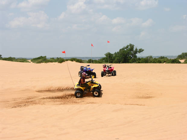 Dune buggies speed over the sand at Little Sahara State Park. (Provided)