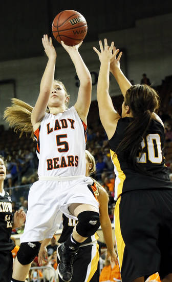 Cheyenne-Reydon's Morgan Latta (5) shoots over Kiowa's Lauren Smith (20) during a Class A girls semifinal game of the state high school basketball tournament between Cheyenne-Reydon and Kiowa at Jim Norick Arena, The Big House, on State Fair Park in Oklahoma City, Friday, March 1, 2013. Photo by Nate Billings, The Oklahoman