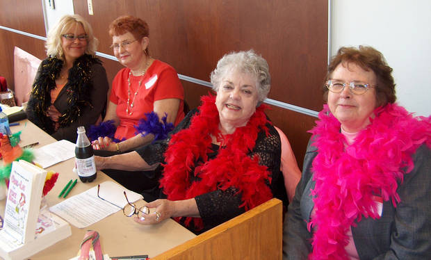 BOOKS AND FEATHERS: Signing their book, CHIK-LIT for FOXY HENS, at the Oklahoma City Writers meeting recently are from left, seated: Paula Jean Watkins, Jackie King, Peggy Fielding and Sharon Ervin.<br/><b>Community Photo By:</b> Carolyn Leonard<br/><b>Submitted By:</b> Carolyn,