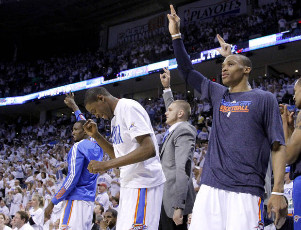 Oklahoma City's Kevin Durant (35) and  Russell Westbrook (0) celebrate during game five of the Western Conference semifinals between the Memphis Grizzlies and the Oklahoma City Thunder in the NBA basketball playoffs at Oklahoma City Arena in Oklahoma City, Wednesday, May 11, 2011. Photo by Sarah Phipps, The Oklahoman