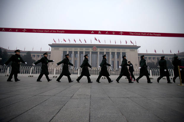Chinese soldiers march outside the Great Hall of the People before the closing ceremony of the National People's Congress in Beijing, China, Sunday, March 17, 2013. (AP Photo/Alexander F. Yuan)