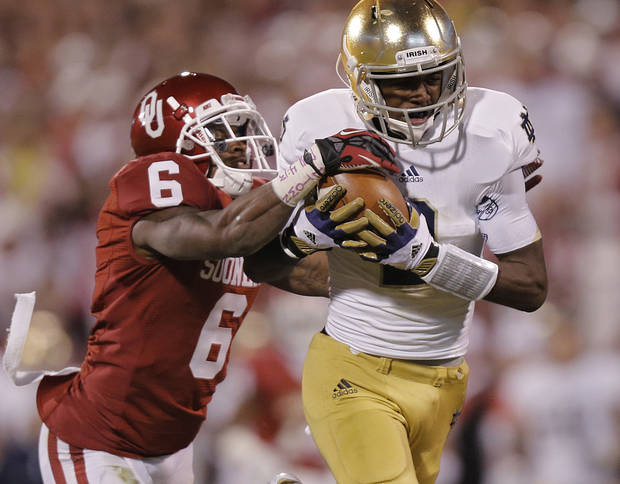 Notre Dame 's Chris Brown (2) makes a 50 yard pass reception in front of OU's Demontre Hurst (6) during the college football game between the University of Oklahoma Sooners (OU) and the Notre Dame Fighting Irish at the Gaylord Family-Oklahoma Memorial Stadium on Saturday, Oct. 27, 2012, in Norman, Okla. Photo by Chris Landsberger, The Oklahoman