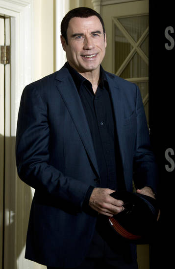 US actor John Travolta  arrives at the photo call for 'Savages', at a central London hotel, Wednesday, Sept. 19, 2012. (AP Photo/Joel Ryan) ORG XMIT: LENT110