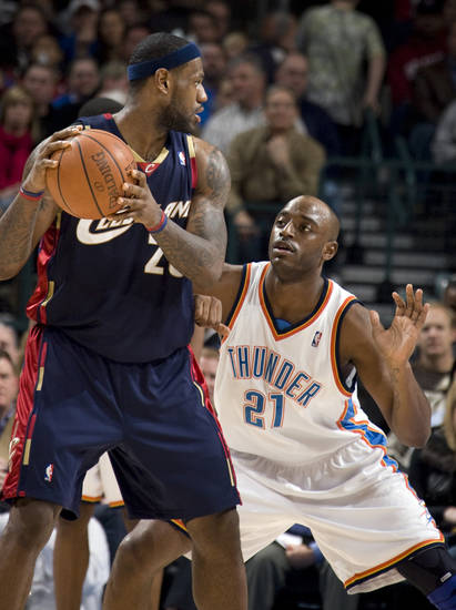 Cleveland's LeBron James looks to pass as Oklahoma City's Damien White (21) defends during the NBA game between the Oklahoma City Thunder and Cleveland Cavaliers, Sunday, Dec. 21, 2008, at the Ford Center in Oklahoma City. PHOTO BY SARAH PHIPPS, THE OKLAHOMAN