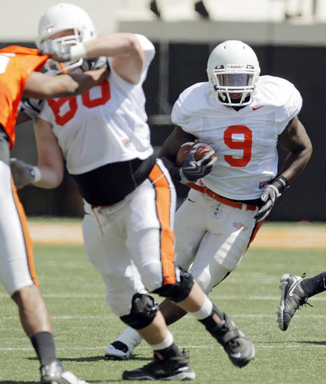 OSU's Kye Staley (9) carries the ball during the Orange/White spring football game for the Oklahoma State University Cowboys at Boone Pickens Stadium in Stillwater, Okla., Saturday, April 16, 2011. Photo by Nate Billings, The Oklahoman