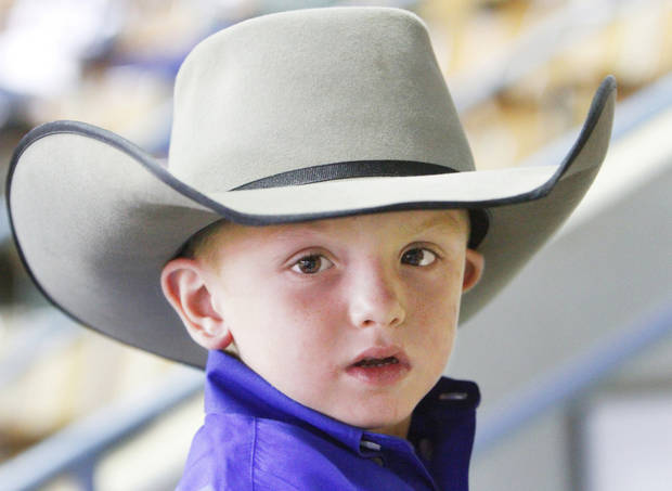 Rider Morris, 5, Muleshoe, TX, watches his dad compete in the U.S. Team Roping Championships at the State Fair Park, Saturday, October 22, 2011.          Photo by David McDaniel, The Oklahoman