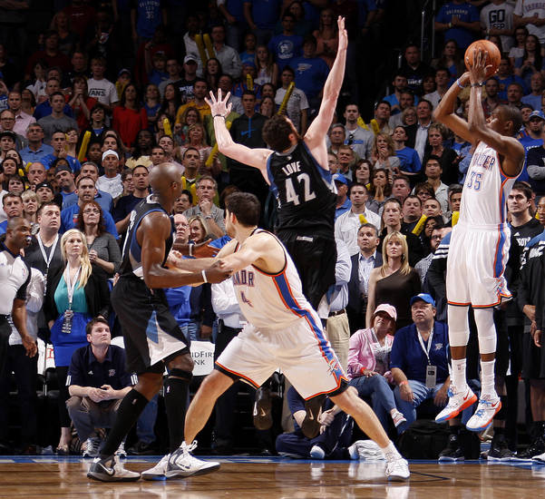 Oklahoma City's Kevin Durant (35) shoots a three-point basket to send the game in a second overtime during the NBA basketball game between the Oklahoma City Thunder and the Minnesota Timberwolves at Chesapeake Energy Arena in Oklahoma City, Friday, March 23, 2012. Photo by Bryan Terry, The Oklahoman