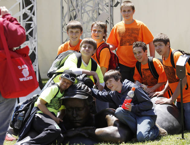 A group of students in the Davis art club have their photo taken in, on and around a metal sculpture at the Festival of the Arts in downtown Oklahoma City  Wednesday, April 24, 2013. The Hunters are from Piedmont. Photo by Doug Hoke, The Oklahoman