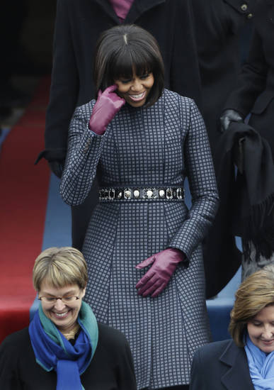 First lady Michelle Obama arrives at the ceremonial swearing-in of President Barack Obama at the U.S. Capitol during the 57th Presidential Inauguration in Washington, Monday, Jan. 21, 2013. (AP Photo/Pablo Martinez Monsivais)