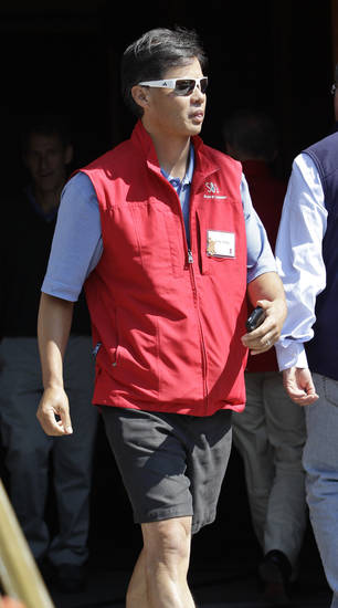 Yahoo co-founder Jerry Yang leaves a the Allen & Company Sun Valley Conference in Sun Valley, Idaho, Thursday, July 12, 2012. Yang did not attend the Yahoo shareholders meeting on Thursday. (AP Photo/Paul Sakuma)