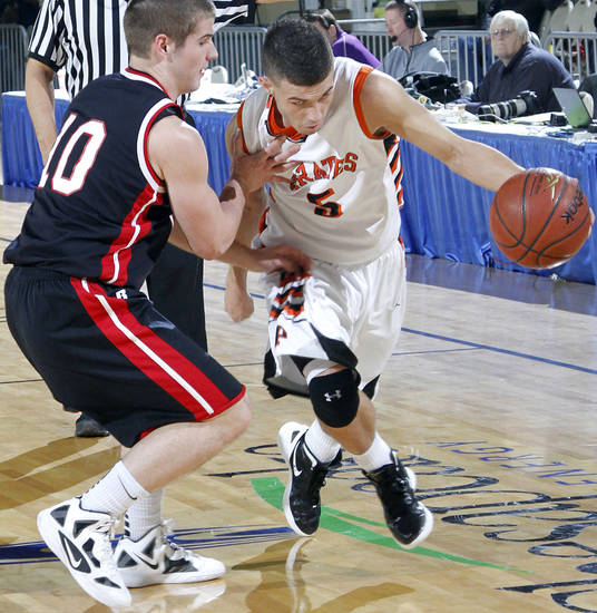 Preston's Chance Leblanc (5) drives past Carnegie's Cameron Nix (10) during the first round 2A boy's State Basketball Championship game between Preston High School and Carnegie High School at the State Fair Arena on Thursday, March 8, 2012 in Oklahoma City, Okla.  Photo by Chris Landsberger, The Oklahoman