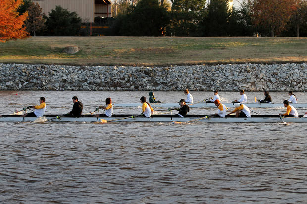 Crews from Santa Fe South and Aztec Charter School compete during the OKC Riversport Youth League Championship on the Oklahoma River in downtown Oklahoma City, Wednesday, November 16, 2011. PHOTO BY HUGH SCOTT, FOR THE OKLAHOMAN ORG XMIT: KOD
