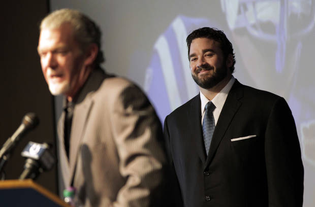 Jeff Saturday, right, listens to Indianapolis Colts owner Jim Irsay during a news conference before signing a one-day contract in order to retire as a Colts player, Thursday, March 7, 2013, in Indianapolis. Saturday spent 13 seasons in Indianapolis before signing with Green Bay last year. (AP Photo/AJ Mast)