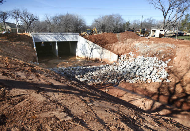 Work continues on the Bryant Avenue bridge replacement project. Asphalt base work is expected to be completed this week on the east side of the roadway. PHOTOS BY PAUL HELLSTERN, THE OKLAHOMAN