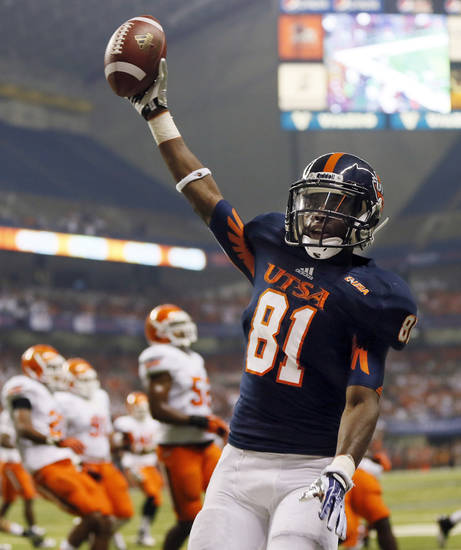 UTSA's Kenny Bias (81) celebrates a first-quarter touchdown during a college football game between the University of Texas at San Antonio Roadrunners (UTSA) and the Oklahoma State University Cowboys (OSU) at the Alamodome in San Antonio, Saturday, Sept. 7, 2013.  Photo by Nate Billings, The Oklahoman