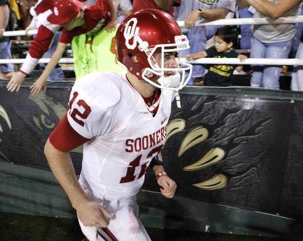 Sooner quarterback Landry Jones enters the field for the second half of the college football game in which the University of Oklahoma Sooners (OU) was defeated 45-38 by the Baylor Bears (BU) at Floyd Casey Stadium on Saturday, Nov. 19, 2011, in Waco, Texas.   Photo by Steve Sisney, The Oklahoman