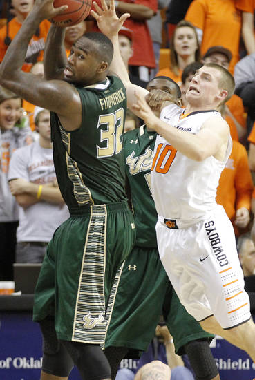 South Florida Bulls' Toarlyn Fitzpatrick (32) and Oklahoma State 's Phil Forte (10) go after a loose ball during the college basketball game between Oklahoma State University (OSU) and the University of South Florida (USF) on Wednesday , Dec. 5, 2012, in Stillwater, Okla.   Photo by Chris Landsberger, The Oklahoman