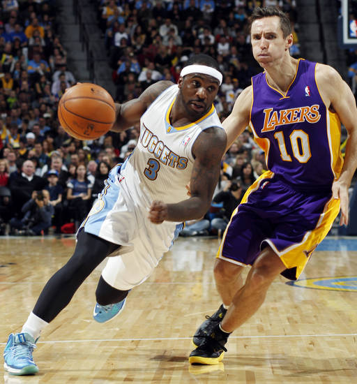 Denver Nuggets guard Ty Lawson (3) drives against Los Angeles Lakers guard Steve Nash in the fourth quarter of their NBA basketball game in Denver, Wednesday, Dec. 26, 2012. The Nuggets won 126-114. (AP Photo/David Zalubowski)