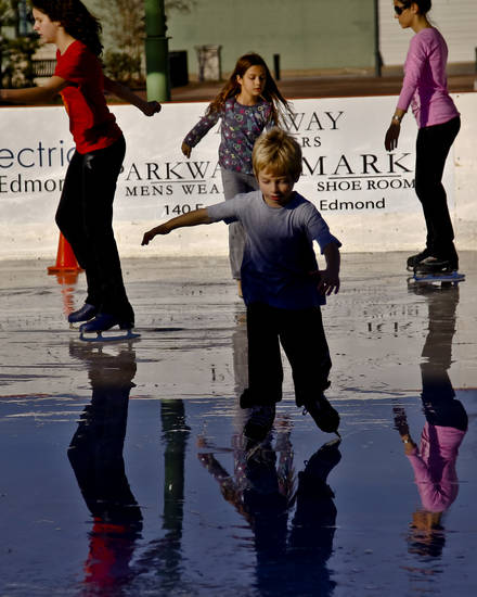 Roy Diehl III skates at the Edmond outdoor ice skating rink on Sunday, Dec. 2, 2012, in Edmond, Okla.   Photo by Chris Landsberger, The Oklahoman