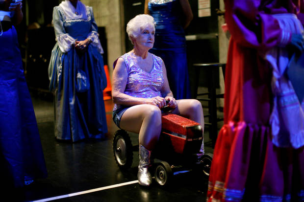 Contestant Naomi Schuh of Moore waits to make her entrance on a miniature tractor for the talent portion of the Ms. Oklahoma Senior America Pageant. Photo by Bryan Terry, The Oklahoman