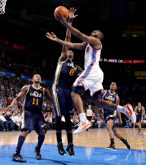 Oklahoma City's James Harden (13) goes by Utah's Earl Watson (11), Josh Howard (8), and Alec Burks (10) during an NBA game between the Oklahoma City Thunder and the Utah Jazz at Chesapeake Energy Arena in Oklahoma CIty, Tuesday, Feb. 14, 2012. Photo by Bryan Terry, The Oklahoman