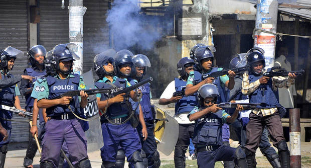 Bangladeshi policemen disperse protesters in Rajshahi, Bangladesh, Friday, March 1, 2013. Protesters clashed with police for a second day Friday as the death toll rose to at least 44 in clashes triggered by a death sentence given to Delwar Hossain Sayedee, one of the top leaders of the country's largest Islamic party Jamaat-e-Islami, for crimes linked to Bangladesh's 1971 independence war, police said. (AP Photo)