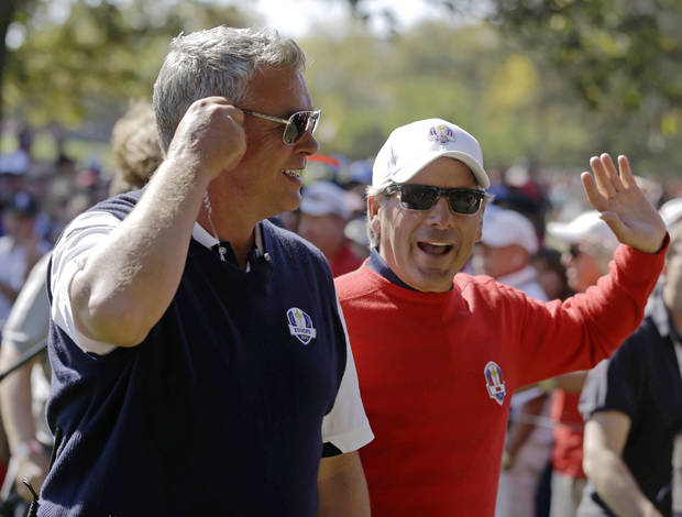 Co-captains Fred Couples and Darren Clarke chat on the 11th hole during a singles match at the Ryder Cup PGA golf tournament Sunday, Sept. 30, 2012, at the Medinah Country Club in Medinah, Ill. (AP Photo/Chris Carlson)  ORG XMIT: PGA145