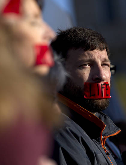 "A member of ""Bound 4 Life"" protests outside the Supreme Court in Washington, Monday, March 26, 2012, as the court began hearing arguments on the constitutionality of President Barack Obama's health care overhaul. (AP Photo/Carolyn Kaster) ORG XMIT: DCCK106"
