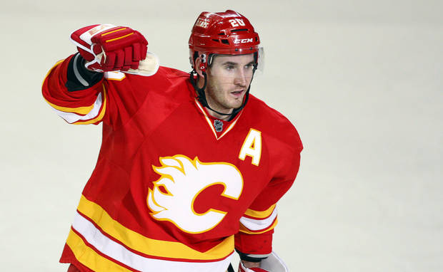 Calgary Flames' Curtis Glencross celebrates his goal against the Phoenix Coyotes during the third period of an NHL hockey game in Calgary, Alberta, Sunday, Feb. 24, 2013. Calgary won 5-4. (AP Photo/The Canadian Press, Jeff McIntosh)