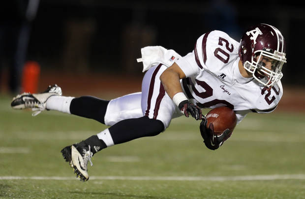 Ada's Mason Girdley dives forward during the high school playoff game between Ada and Clinton at Putnam City High School in Oklahoma City, Friday, Nov. 23, 2012. Photo by Sarah Phipps, The Oklahoman