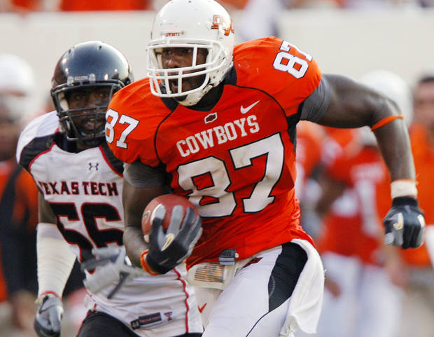 Oklahoma State's Brandon Pettigrew (87) races past Texas Tech's Kellen Tillman (56) for a touchdown during the second half of the college football game between the Oklahoma State University Cowboys (OSU) and the Texas Tech University Red Raiders (TTU) at Boone Pickens Stadium  on Saturday, Sept. 22, 2007, in Stillwater, Okla. 