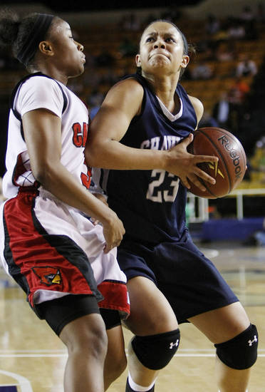 Shawnee's Kelsee Grovey (23) moves to the basket against East Central's Janee Arnold (3) during the Class 5A girls high school basketball state tournament championship game between Shawnee and East Central at the Mabee Center in Tulsa, Okla., Saturday, March 10, 2012. Shawnee won, 45-41. Photo by Nate Billings, The Oklahoman