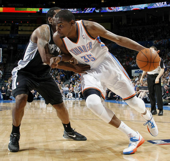 Oklahoma City's Kevin Durant (35) drives the ball against San Antonio's Kawhi Leonard (2) during the NBA basketball game between the Oklahoma City Thunder and the San Antonio Spurs at Chesapeake Energy Arena in Oklahoma City, Friday, March 16, 2012. Photo by Nate Billings, The Oklahoman