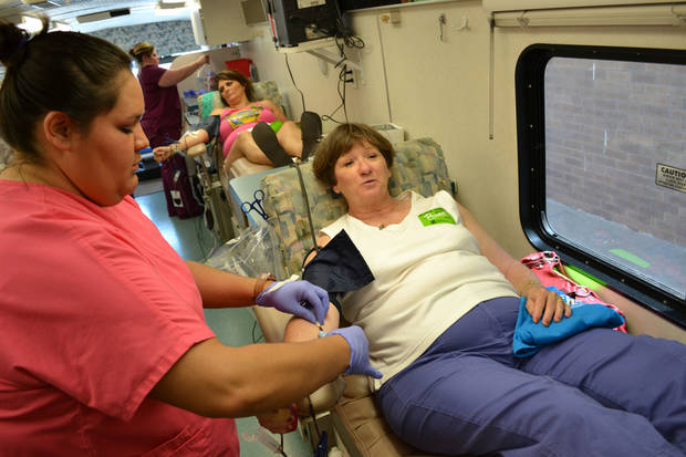 Christa Salazar, a phlebotomist with the Oklahoma Blood Institute, draws blood from donor Charlotte Donaho, of Oklahoma City, on Saturday at Quail Springs Mall. Photo by Zeke Campfield, the Oklahoman