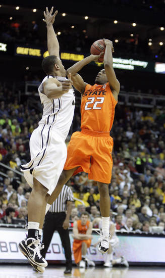 Oklahoma's Markel Brown (22) shoots over Missouri's Steve Moore (32) during the Big 12 tournament men's basketball game between the Oklahoma State Cowboys and Missouri Tigers the Sprint Center, Thursday, March 8, 2012. Photo by Sarah Phipps, The Oklahoman