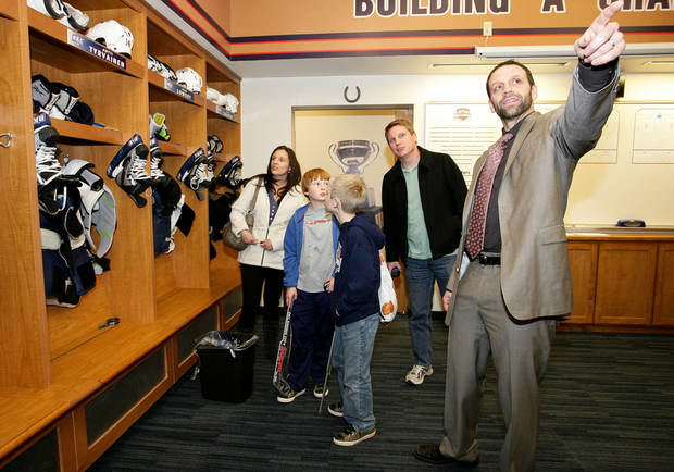 The Crawford family visits the Barons locker room on Dec. 27, 2011, when the Barons played the Rochester Americans in an American Hockey League game at the Cox Convention Center. From left: Alissa, Paul, Joel and Paul Crawford with Bryan Helmer. PHOTO BY STEVEN CHRISTY, OKLAHOMA CITY BARONS <strong>Steven Christy - Steven Christy</strong>