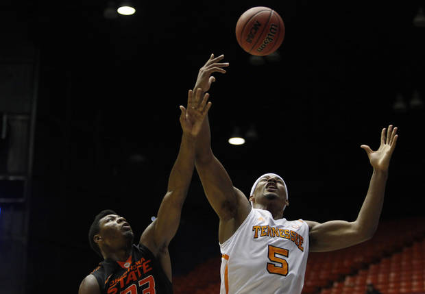 Oklahoma State's Marcus Smart, left, and Tennessee's Jarnell Stokes battle for a rebound during a NCAA college basketball game in Bayamon, Puerto Rico, Friday, Nov. 16, 2012. (AP Photo/Ricardo Arduengo) ORG XMIT: SJU102