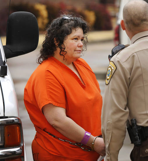 Kimberly Crain arrives at the Pottawatomie County Courthouse Wednesday morning, Jan. 9, 2013.   Crain is a former teacher at McLoud Elementary School who was charged with sex crimes for allegedly photographing some of her female students in skimpy clothing and underwear. She and former OBU professor Gary Doby face similar charges in the incident.    Photo by Jim Beckel, The Oklahoman